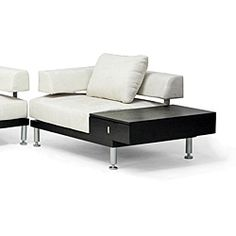 This contemporary sofa set includes a sofa, loveseat and chair with an end table. It features a striking black wood base with contrasting steel legs and hardware and an elegant cream colored microfiber upholstery.