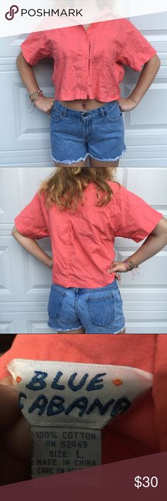 Vintage button up large crop top. Cotton Vintage blue cabana large button up crop top. 1980s. Arm to arm 19 and shoulder to hem 19. Shoulder pads. Perfect with the vintage jeans we have listed. Shorts in this listing are also for sale. Vintage Tops Crop Tops