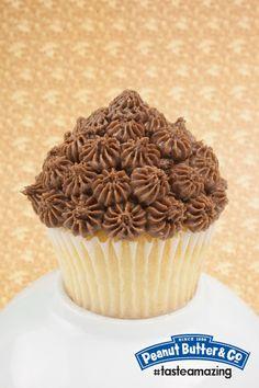 Vanilla cupcake with Dark Chocolate Dreams peanut butter icing.#tasteamazing #treatyourself