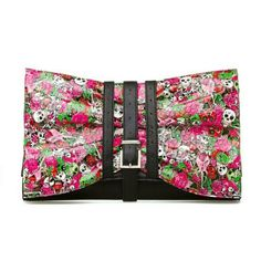 Shoedazzle Yorick Clutch Rocker-chic Pink & Skulls Shoedazzle Yorick Clutch Pink & Skulls. Comes with shoulder strap.   Yorick is the perfect clutch to enhance your rocker-chic style. A graphic print of flowers and artistic skulls add feminine touches. Shoe Dazzle Bags Clutches & Wristlets