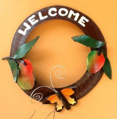 Recycled Tire Welcome Sign mangos and butterfly from www.cooltireswings.com