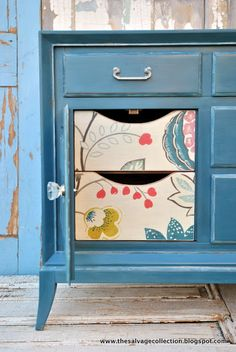 beautiful blue dresser with fabric drawers