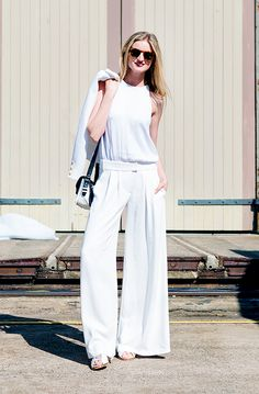 Hello, chicness! For the ultimate summer-ready look, wear a pair of wide-leg pants with a simple white tank and sandals. #candicelake #streetstyle
