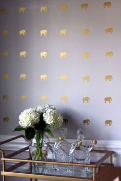 Create the look of all-over wallpaper with charming mini elephants. Since it's all about getting the pattern precise, try them in measured doses over a bar or in an entryway. See Southern Nest for more »   - HouseBeautiful.com