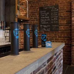 polished concrete bar top, brick walls, chalk menu
