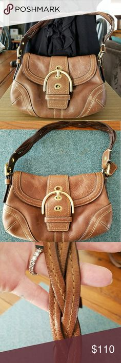 Coach Vintage Style Bag 100% Authentic Vintage Style Coach Bag. Heavy brown vintage leather with a gorgeous braided strap. Beautiful gold buckle closure with one inside zipper and two inside inserts. Comes with original dust bag. Reasonable offers accepted! Happy poshing! Coach Bags
