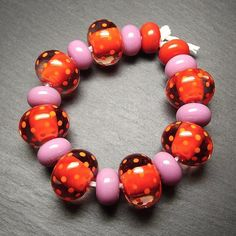 Lampwork glass 'Flamenco' beads by Laura Sparling #lampworkbeads #polkadots #redandpink #beadsbylaura