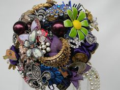 David Tutera ordered a brooch bouquet by broochbouquets on Etsy, $275.00  A wonderful way to use your heirloom jewelry!   www.weddingsbytanya.com