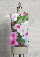 Floral Sleeveless Top: What a beautiful product! This top, cut with a flattering A-line and a rounded asymmetric hem, will make you look and feel effortlessly beautiful - day or night.