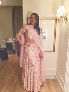 Sonakshi Sinha is proving to us that pastels are in and how! Get in the wedding trend with this pretty pastel lehenga paired with classy champagne accessories. Indian Lehenga, Lehenga Choli, Blue Lehenga, Saree, Anarkali, Bollywood Celebrities, Bollywood Fashion, Bollywood Actors, Indian Attire