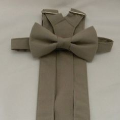 Portobello Suspenders and Portobello Bow Tie. Perfect for your Groomsmen, Ring Bearer, Best Man, Ushers, and Groom. Free Fabric Sample Available. Grey Suspenders, Groomsmen Suspenders, Groom And Groomsmen, Wedding Suspenders, Popular Wedding Colors, Fall Wedding Colors, Free Fabric Samples, Free Fabric Swatches, Grey Bow Tie