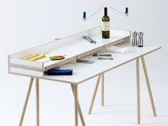 Bernotat & Co's Doppeldecker Table combines work and leisure with a movable lid that when flipped up creates a desk and when flipped down, a dining table.
