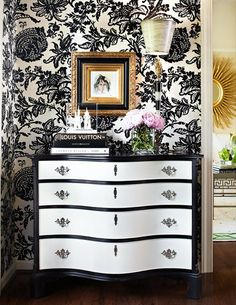 new project.  glossy black/white dresser.  i want the wallpaper too! : )