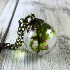 Real moss and tiny pink blossom encased in a beautiful resin orb pendant just added to my shop