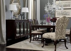Love dark furniture, gray walls with the two upholstered chairs and crystal chandelier.