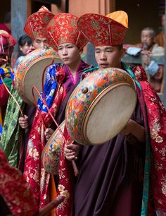 beating the drums at a festival, bhutan