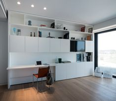 This apartment by Michal Han Interior Design faces Tel Aviv's beautiful seafront. The planning process was both unique and challenging as a result of its semi-circular shape #workspace