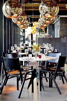 The Dock Kitchen London uses bold #lightfixtures to create #finedining #ambience