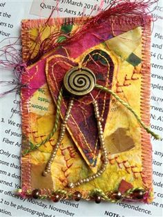 Created my own version of this one to send to m daughter for valentine. I made a fabric postcard. Whoopee!