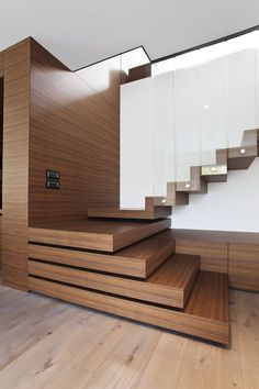 Staircase - dual design showcasing natural wood blocks separated by full length (possibly Plexiglass) panes.