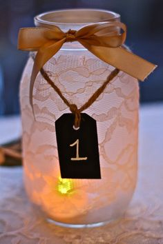 Set of 10 Lace Mason Jars with chalkboard tags - wedding table numbers, shower table numbers, rustic charm. $115.00, via Etsy.