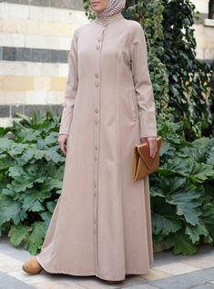 Comfortable, practical, modern, and fun, the Abidah Jilbab is now available in a colder weather weight lyocell and cotton blend. Practical buttons and pockets add a utilitarian vibe to this jilbab, which was made for layering. Wear it open or closed for the utmost versatility during the changing seasons.