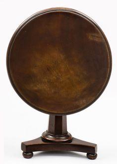"English Georgian mahogany round tilt-top table with an octagonal pedestal on a triform base with bun feet.      English Circa 1820     Height: 9"" | Diameter: 10""     Item #6164     Price: $1,600"