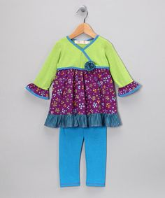 Offering a pop of color, rows of radical ruffles and plenty of personality, this outfit is perfect for playdates and other fun adventures. The set includes a cool tunic with a prim rosette and matching set of leggings. Includes tunic and leggings62% polyester / 33% rayon / 5% spandexMachine wash; hang dry