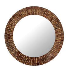 A maze of woven patterns glistens within the glass tiles that frame this round mirror. Kamal crafts the modern design of this mirror frame by hand over a wooden base in a palette of brown, maroon and golden yellow hues. $174