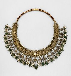 *Necklace made in India, ca. 1850. Enamelled gold, set with diamonds, pearls and emeralds.