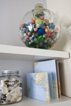 Collection of Super Balls [bouncy balls] displayed in a kid's room in a clear, globe-shaped container (design by Michelle Hinckley via Houzz)