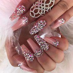 Love these blush colored rhinestone coffin nails. Acrylic nails. coffin shaped. neutral. diamonds and rhinestones. nail art. nail designs. long nails.