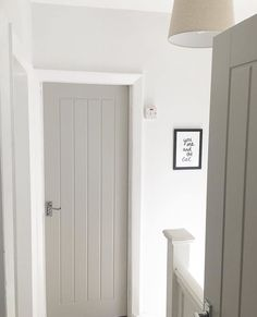 Farrow & Ball Paint – Purbeck Stone Grey is demure, on trend, and works wonderfully to add depth to this white hallway. It gives a modern finish to these vintage style doors and makes for a contemporary cottage look www. Grey Interior Doors, Interior Door Styles, Painted Interior Doors, Grey Doors, Home Interior Design, Cottage Doors Interior, Paint Doors, White House Interior, Interior Door Colors