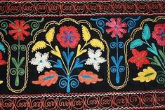 Suzani style embroidered wall hanging, bright and beautiful. Velvet background.