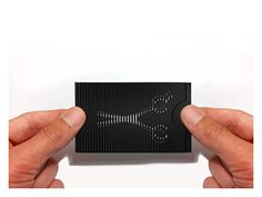 Using a simple optical illusion from an old cinematography concept, the card consists of two parts—a piece of paper with a blurred version of the graphic on it and a striped envelope.   By pushing ...