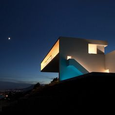 This bright-white house in Alicante by Fran Silvestre Arquitectos functions as a cliffside viewing platform beside the Balearic Sea.
