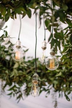 Greenery and Edison Bulb Chandelier | Sean Money   Elizabeth Fay Photography | See More! http://heyweddinglady.com/farm-table-luxe-organic-wedding-inspiration/