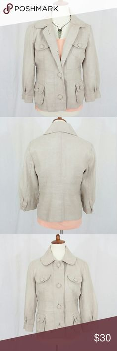 """Linen Blend Rafaella Blazer With a durable woven linen/cotton fabric, 3/4 sleeves, four functional pockets and oversize buttons, this jacket has that perfect look to pair with your summer wardrobe when the AC at work or the movie theater has been cranked too low! Fabric is 80% linen and 20% cotton. Fully lined. Measures approximately 38"""" in the bust and 34"""" in the waist. Shoulder to hem measures 23.5"""". Shown pictured with Ann Taylor 100% linen t-shirt which is also available for purchase in…"""