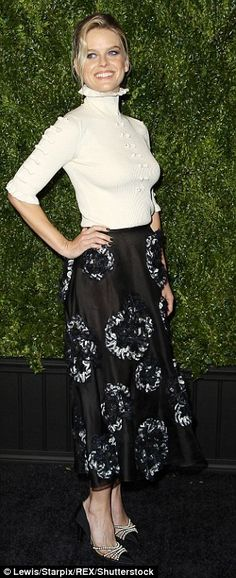 Black and white: Alice Eve teamed a white top with black skirt for the dinner...