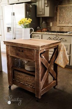 Rustic Kitchen Island. Perfect size for a small kitchen, and the towel hooks are a good idea