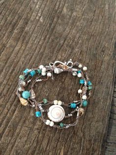 Shells, turquoise, silver & beads on brown cord. Wrapped for a bracelet Unwrapped a necklace. Beach Bracelets, Beach Wrap, Shell Bracelet, Daughter Love, Anklet, Silver Beads, Shells, Gems, Turquoise
