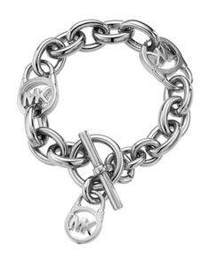 Omg omg omg!!! I looooove this!!! So cute...on my wish list...Michael there are so many things I love of yours right now....    Michael Kors Logo-Lock Charm Bracelet, Silver.