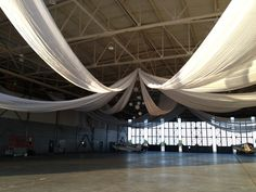 Airplane hangar wedding...how cool that I found a pic for this!! Could we do this??