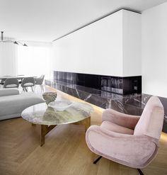 berlin - penthouse - living area - dining area - dining area - built-in - cabinet - drawer - library - herringbone - oak - floor - walnut-panell - elevator core - fireplace - wohnung - wohnbereich - kamin - marmor - schwarz - weiß - fischgräte - eiche - sessel - tisch - essbereich