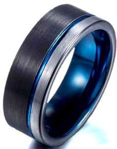 Men's gun metal black tungsten wedding band with blue offset groove. The Nexus has a sleek pipe cut design. The black and silver brushed finish is connected w