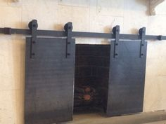 barn-door-style-steel-plate-fireplace