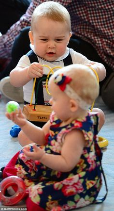 George looked a tad bemused as he inspected his toy while one of his playmates gazed with equal perplexity at hers