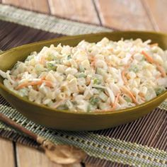 Macaroni Coleslaw Recipe -My friend Peggy brought this coleslaw to one of our picnics, and everyone liked it so much, we all had to have the recipe. —Sandra Matteson, Westhope, North Dakota