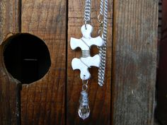 Wire wrapped puzzle piece: nice idea for Autism jewelry:  Puzzle Piece Pendant and Clear Briolette Necklace Wire Wrapped Mother's Day Gift. $10.00, via Etsy.