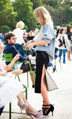 Oversized sweater paired with a high-slit skirt